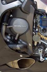 Hondas_800cc_v4_motogp_bike_breaks_cover_4